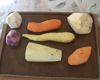 And now for those who are truly fascinated, just peeled -- Upper left = Boniato; Upper center = Red Garnet Yam; Upper right = Tropical Yam; Center left = Purple Potato; Center middle = Japanese Yam; Bottom middle = Ghana Yam; Bottom right = American sweet potato;