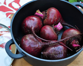 Rub the oil all over the beet skins.