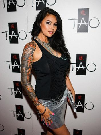 Beautiful sexy girl with sleeve tattooed dragon tattoo.
