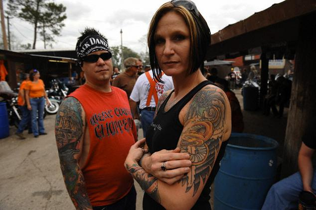 A female with yellow dragon tattoo on her arm.