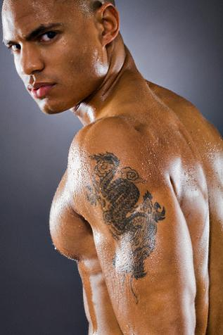 Girls rarely sport dragon tattoos, but they are quite popular among men.