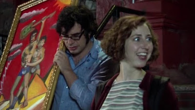 Mel and Jemaine showing off her artwork