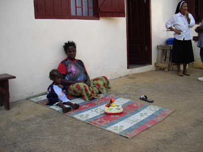 A pregnant mother watching over a recovering malnutrition child.