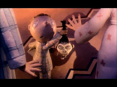 A boy gets a shrunken head for Christmas