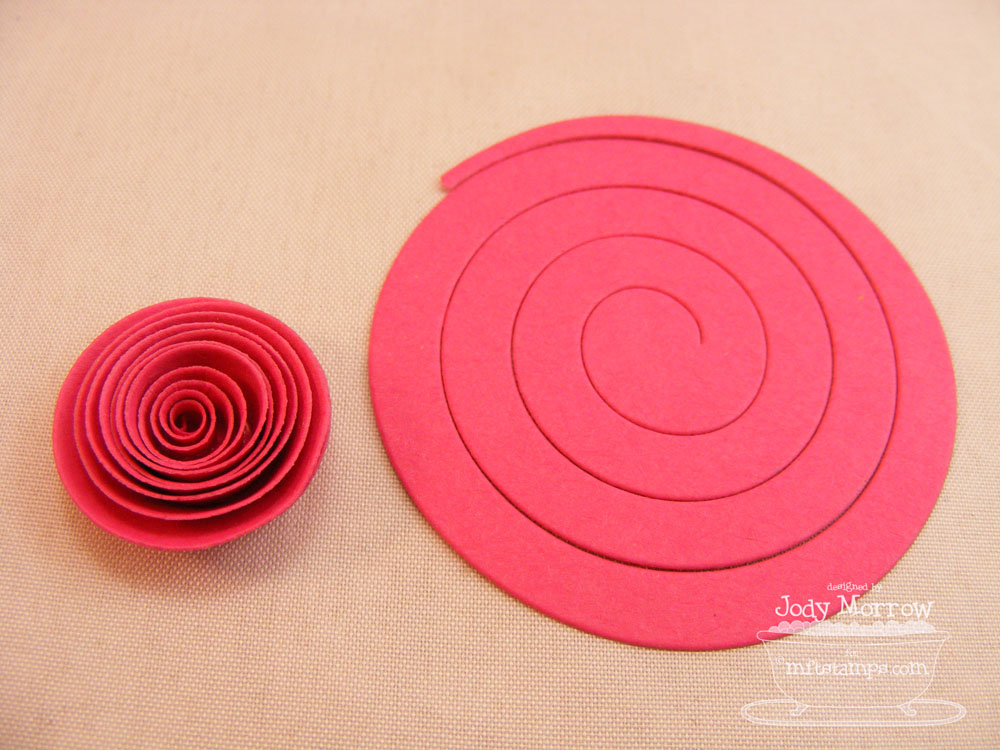 flower die and a paper quilling tool along with the die cut prior to rolling see how nice and neat it came out and how tiny the center is
