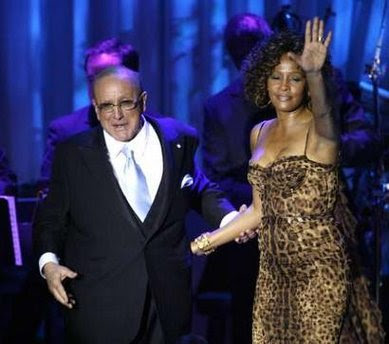 Singer Whitney Houston waves at the crowd next to Clive Davis at the conclusion of her performance at the 2009 Grammy Salute to Industry Icons event, honoring Davis in Beverly Hills, California February 7, 2009.