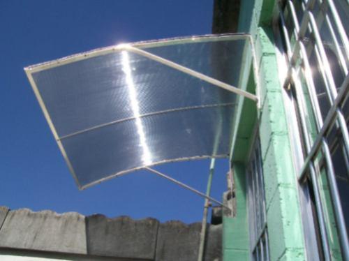 Nossos valores toldo para porta em policarbonato com for Materiales para toldos de aluminio