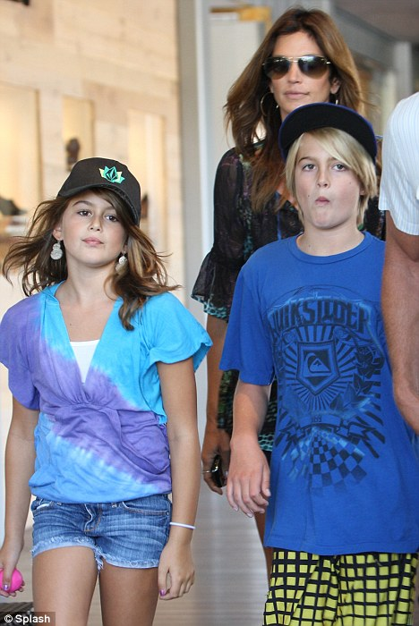 Handsome family: Cindy Crawford walks behind her cute kids Presley Walker