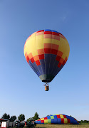 What is it about a big blue sky and a brilliantly colored hot air balloon . (hot air balloon in homerville pic )