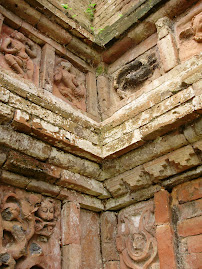 Carved terracotta plaques lining Paharpur walls