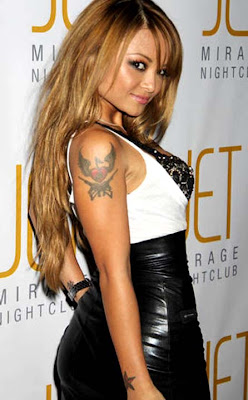 picture of tila tequila arm tattoo