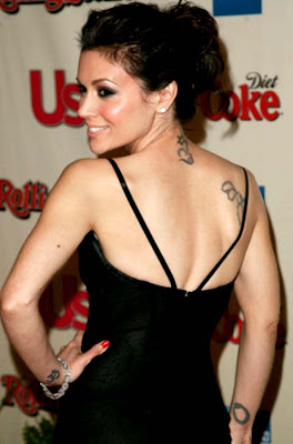Alyssa milano rosary tattoo pictures