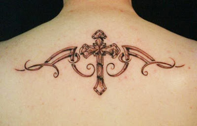 back side tribal cross tattoo