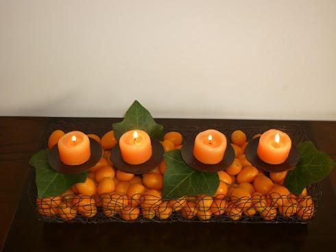 Centro de mesa con quinotos y velas