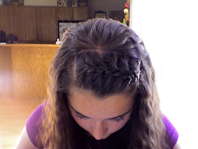 in the middle and pulled backside and pinned up by making French braid.