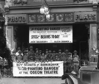 Boy Scouts standing outside the Odeon Theatre