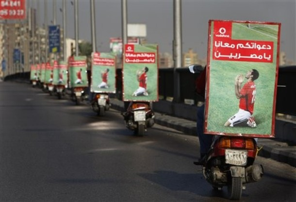 [Egyptian+motorcyclists+drive+through+the+streets+of+Cairo+with+posters+on+their+backs+supporting+their+team+and+reads+in+Arabic+'We+need+your+prayers+Egyptian'+ahead+of+their+upcoming+Nov.+14+World+Cup+2010.jpg]