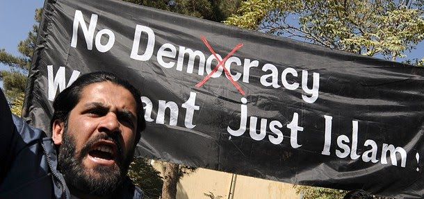 [Afghan+university+students+shout+anti-US+slogans+and+hold+a+banner+reading+'No+Democracy;+We+want+just+Islam!'+during+a+demonstration+in+Kabul+on+October+25,+.jpg]