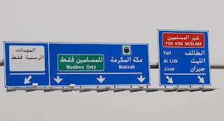 http://1.bp.blogspot.com/_QfVWU-2pVL4/TLis1F6Y2_I/AAAAAAAAPyo/0k5UFBKmUp0/s1600/mecca-muslims-only-road-sign.JPG