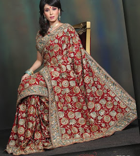 http://1.bp.blogspot.com/_QgCrlQGhyiI/TNvumRbCEdI/AAAAAAAAABg/xzjZ1zQFudk/s1600/red-color-pure-crape-bridal-saree-bridal-sarees-indian-saree-designs.jpg