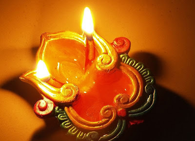 oil lamp symbolizing sacred connection to the seasons and maintaining balance through seasonal changes with Ayurveda
