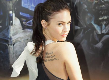 megan fox rib tattoo. Fox has got a tattoo done on