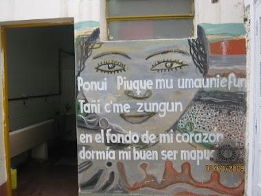 Mural comunitario Dia y noche (fishcug Menuco)
