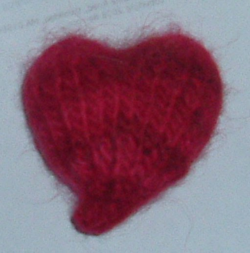 Knitting Hearts Together : Bits of fluff hearts knit together in unity and love