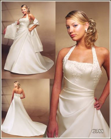 White wedding gown with strapless style and beautiful belt from gray green