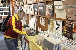 A man shops in Vinyl Junkies, a record shop in London.