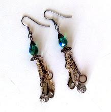 orecchini con catene e perle
