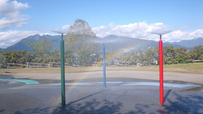 Rainbow near Water Park fountains in a sunny day of september