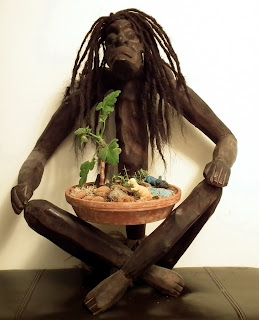 Primitive men in yoga position with Shrubland Rose