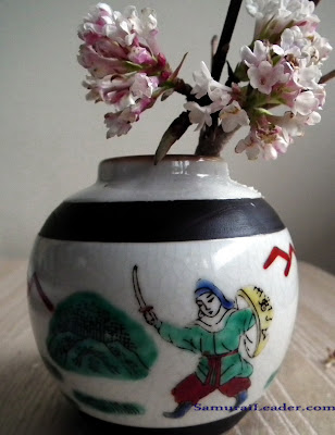 Samurai leader painted on a miniature porcelain vase marked Chenghua on bottom