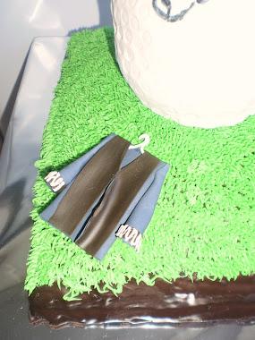 tarta con toga de procurador-golfista y estupendo.