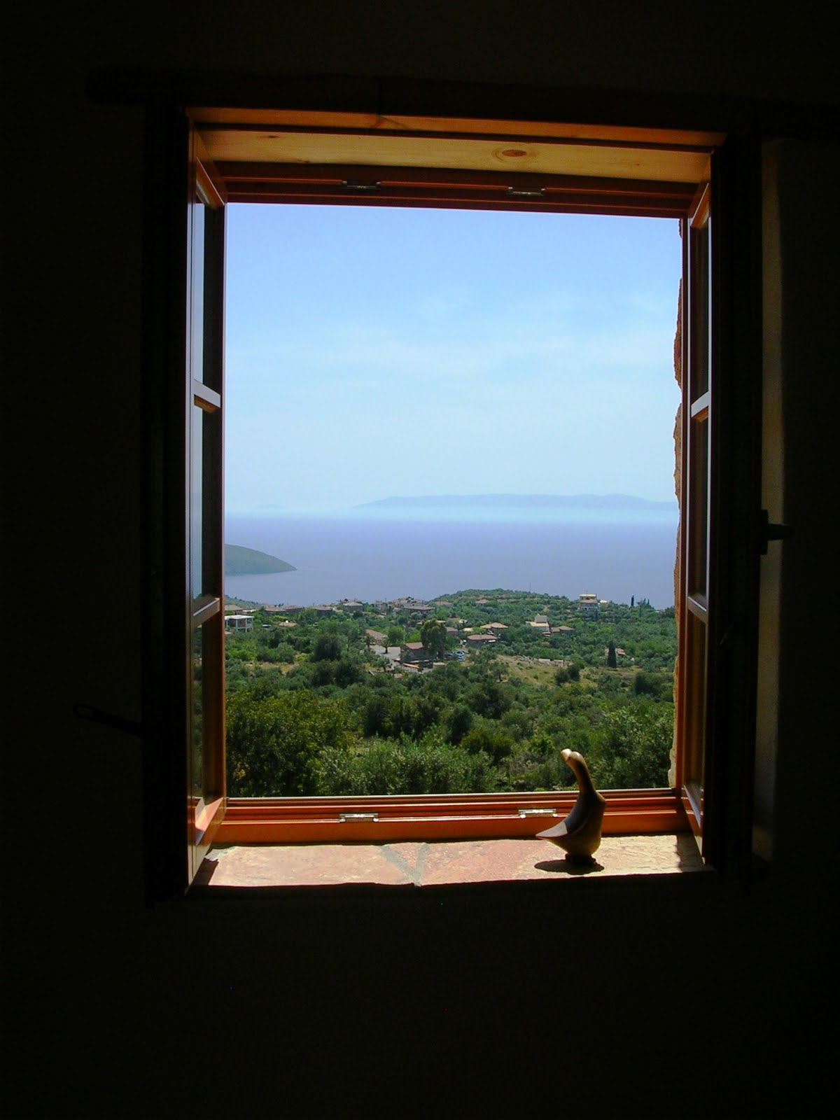 a greek window with a view