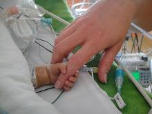 Samuel holding Mommy's hand