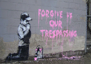banksy forgice us our tresspassing