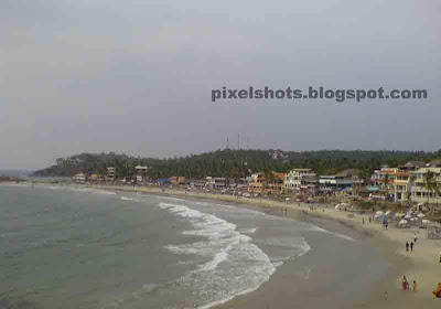 light house beach of kovalam,sky view of beaches in kerala,aerial beach pictures,beach pghotos taken from top of lighthouse in kerala,kerala famous beaches,beach tourism