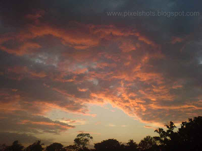 sunset afterglow on the clouds photographs making the clouds glow red