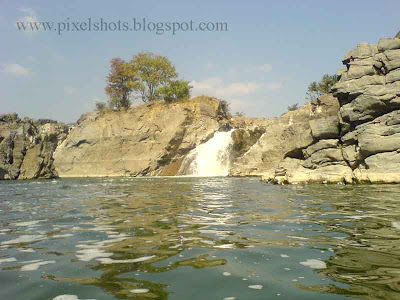 small waterfalls in hoganekkal taken during basket boat journey through river kauvery