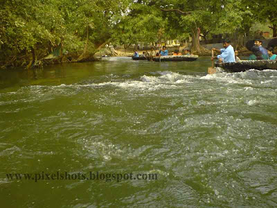 fast green river water current in kauveri river tamilnadu,photograph taken from basket boat journey in a tour trip