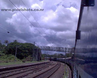 cloudy sky photograph taken from a train in kerala