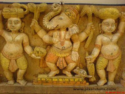 hindu god lord ganesha clay sculpture,ganesha and his fellows sculptured in clay photograph