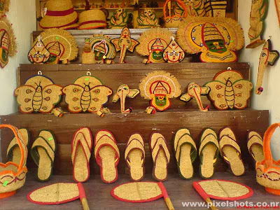 handicrafts made in coir for sale in jew street cochin kerala,handicrafts of coir sandals,coir kadhakali face,elephants,coir hats,coir baskets