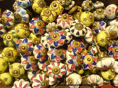colourful pieces of door knobs made of wood for sale in mattancherry jew street shops,photographed from cochin india kerala