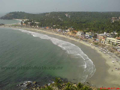 beaches in kerala,aerial view of kovalam beach one of the hottest tourist spot in trivandrum of kerala,aerial scenic photograph of kovalam beach