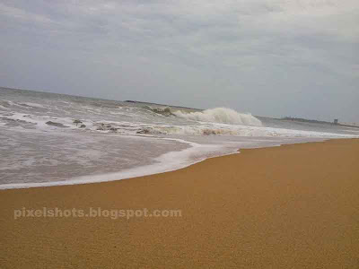 golden beach sand and milky white sea wave,golden shores of kerala beaches,tourist spots in kollam,beautiful beaches of kerala state,beaches near kollam