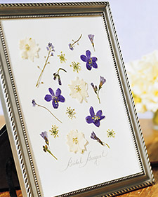 Pressed Flowers in Picture Frame via Martha Stewart Weddings