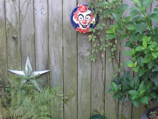 Backyard wall decor, star and clown